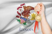 Medal In Hand With Flag On Background - State Of Illinois. Part Of A Series.