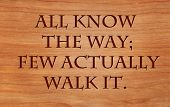 All know the way; few actually walk it - on wooden red oak background