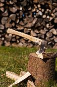 pic of ax  - wooden block with a ax and split wood - JPG