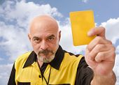 picture of referee  - Senior referee image showing card at the view - JPG