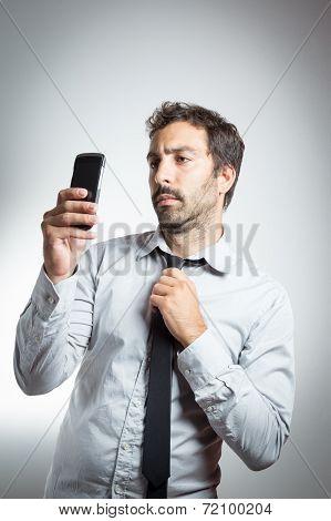 man in suit taking a selfie