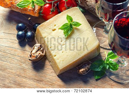 Cheese With Red Wine, Walnuts And Grapes. Food Background