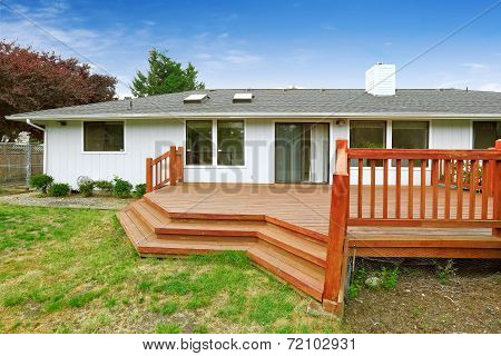 Spacious Walkout Deck With Railings And Stairs