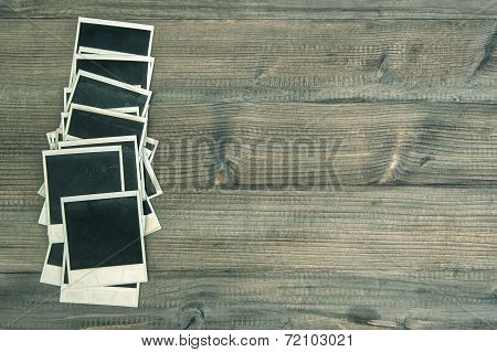 Vintage Instant Photo Frames On Rustic Wooden Background