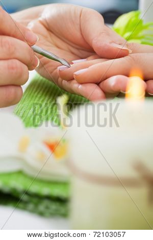 Beautician Giving Manicure Treatment