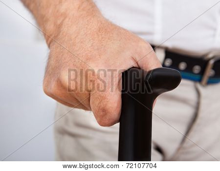 Disabled Senior Man With Walking Stick