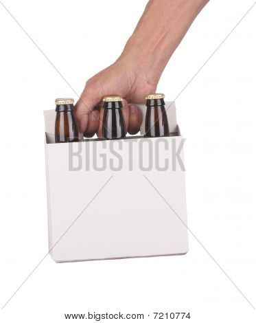 Hand Holding A Six Pack Of Beer Bottles
