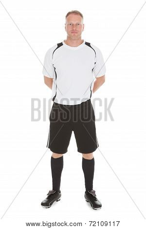 Mid Adult Man In Sportswear Standing Hands Behind Back