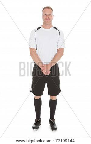 Portrait Of Man In Sportswear Standing Over White Background