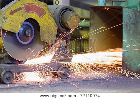 Worker Cutting Metal And Spark By Cutting Machine