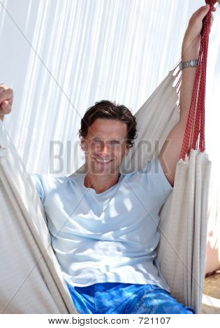 Handsome Middle Aged Man Sitting In Hammock