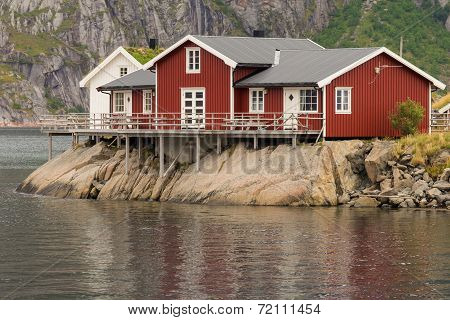 Typical Norwegian Fishing Village With Traditional Huts
