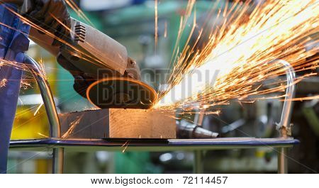 Worker Grinding Steel By Electric Grinding Machine