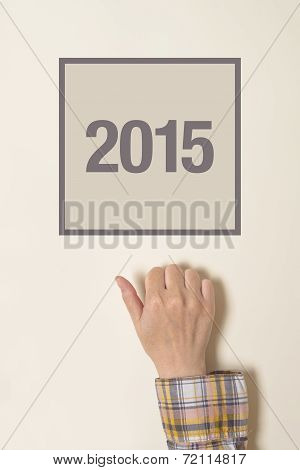Woman Knocking On Door With Number 2015