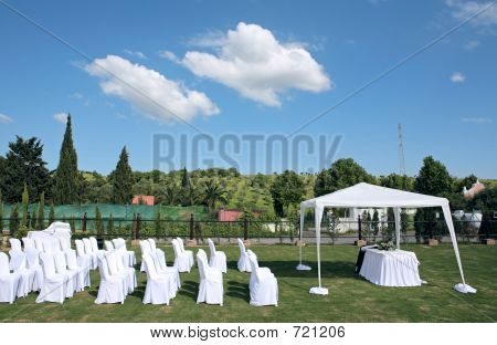 Empty Seats At An Outdoor Wedding