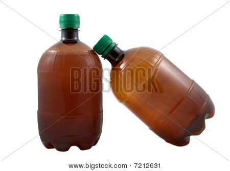 Two Plastic Beer Bottles On A White