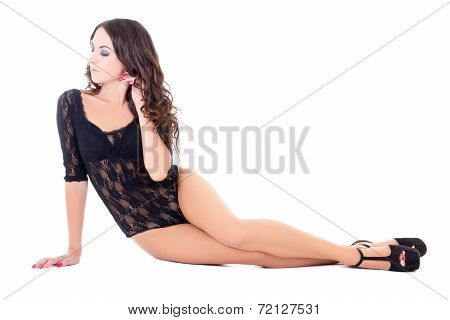 Young Beautiful Sexy Woman In Black Lace Lingerie Sitting Isolated On White