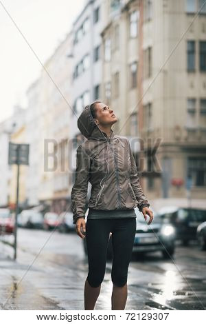 Fitness Young Woman Exposed To Rain While Jogging Outdoors In Th
