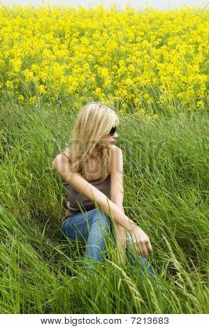 Blond Girl On The Grass