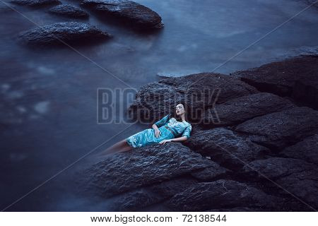 Beautiful young woman on sea
