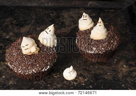 Chocolate Pumpkin Cupcake, Decorated With Meringue Ghosts