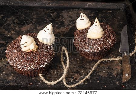 Two Chocolate Pumpkin Cupcakes, Decorated With Meringue Ghosts