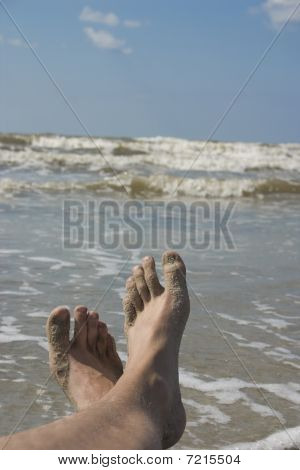 Océano de arena de pies