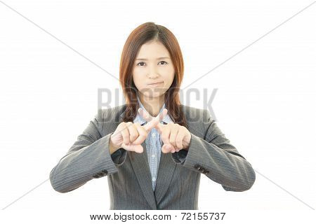 Business woman doing no good sign