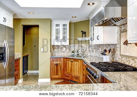 Modern House Interior. Kitchen Room With Shiny Granite Tops And Mosaic Trim
