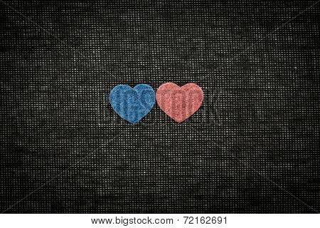 Blue And Red Hearts Against A Dark Background