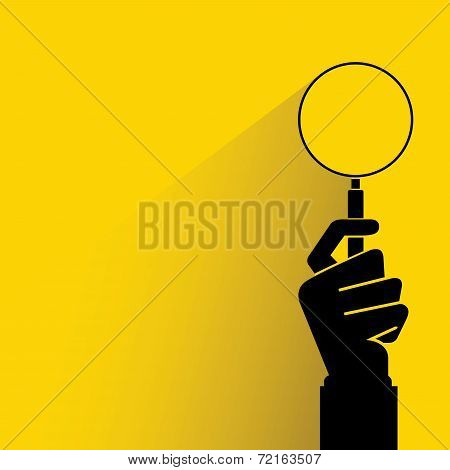 hand holding magnifier glass