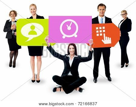 Business People Holding Colorful Boards