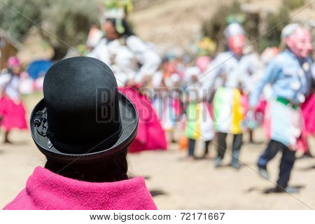 Indigenous Woman Watching Dancers