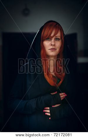 Portrait Of Beautiful Red Hair Woman In Black
