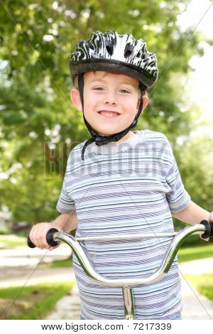 Young Boy Riding A Bike