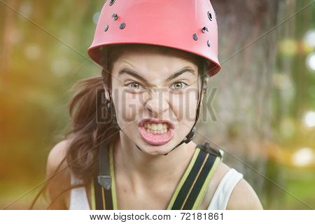 Furious Teenage Girl With Red Climber Helmet
