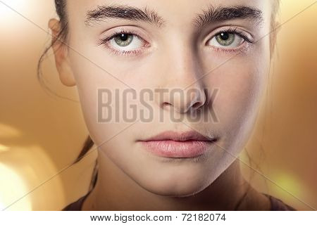 Close Up Portrait Of A Woman With Mysterious Eyes