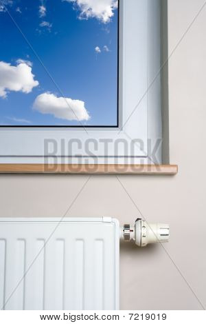 Heater radiator And Blue Sky In Home Interior