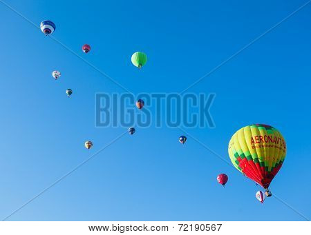 A lot of colored balloons in blue sky