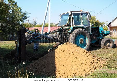 Tractor Digging A Hole