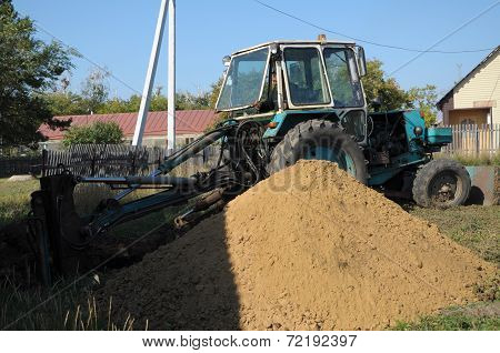 Tractor Digging A Hole Shoveling The Ground