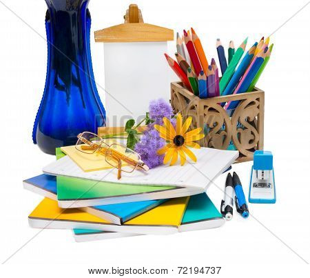 Composition With Flowers In A Vase And School Supplies.