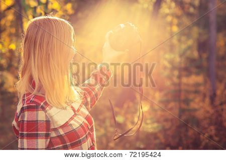 Young Woman with retro photo camera taking selfie shot outdoor
