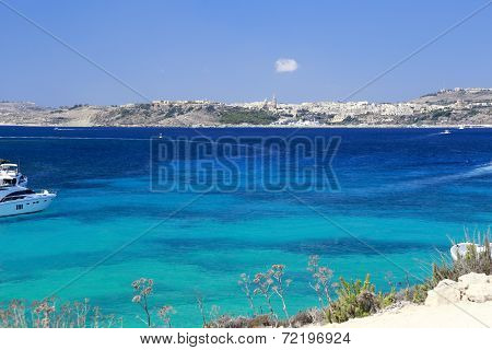 Blue Lagoon In Front Of Gozo Island