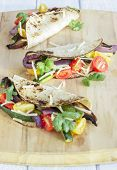 picture of portobello mushroom  - Tacos filled with roasted portobello mushrooms zucchini and purple onions with cherry tomatoes cilantro and monterrey jack cheese - JPG