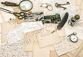 stock photo of nostalgic  - old handwritten french letters and postcards vintage office accessories - JPG
