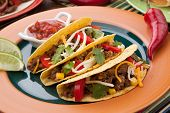 stock photo of tacos  - Assorted Mexican dishes with whole grain corn beef tacos as the main subject - JPG