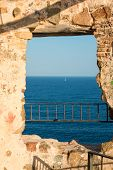picture of saracen  - Padlocks in saracen tower over sea with sailing boat - JPG