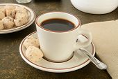 stock photo of shortbread  - Mini gourmet chocolate chip shortbread cookies with a cup of coffee - JPG