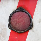 picture of truck-stop  - Light truck on a red strip white wall background - JPG